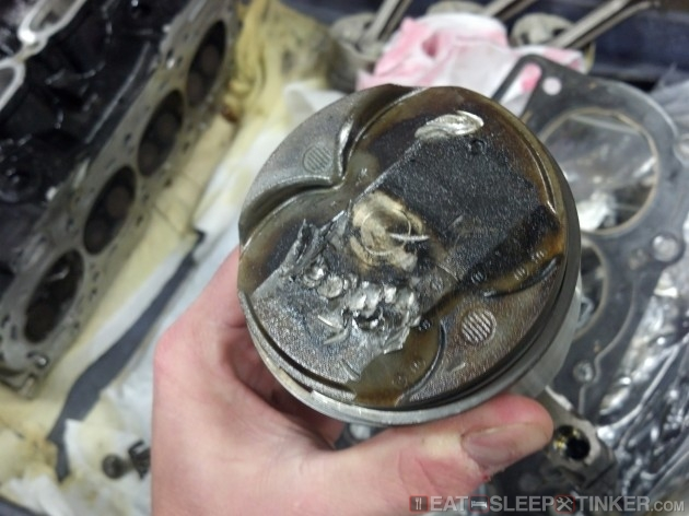 Damaged piston top