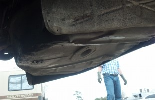 Damage to spare tire well
